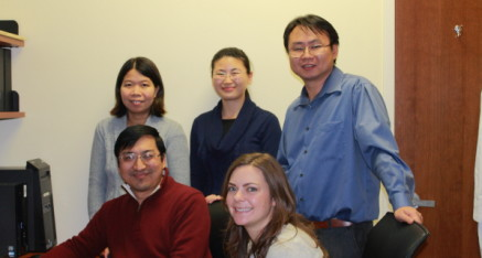 Dr. An Vo (back row, left) oversees MR imaging for the Center of Neurosciences. Dr. Vo is pictured with her colleagues: (back row, L-R) Dr. Shichun Peng and Dr. Chris Tang, and (front row, L-R) Dr. Yilong Ma and the former research assistant Patricia J. Allen.