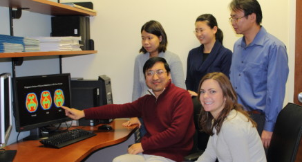 Staff for the Functional Brain Imaging Laboratory, back row, left to right: An Vo, Shichun Peng, Chris Tang; front row: Yilong Ma, Patricia J. Allen. David Eidelberg, Vijay Dhawan, and Phoebe Spetsieris are missing from the picture.