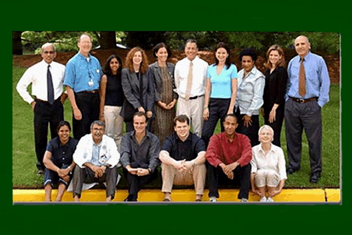 Group photo, 2004. Back row (Left to Right): Thomas Chaly, Claude Margouleff, Vandhana Pillai, Gwenn Smith, Maren Carbon-Correll, David Eidelberg, Maja Trost, Seda, Christine Edwards, Abdel Belakhlef; Front row (Left to Right): Roseta Persaud, Vijay Dhawan, Marc Mentis, John Okulski, Dominique Delalot, Anna Barnes.